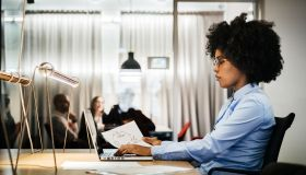 Young black businesswoman working in office