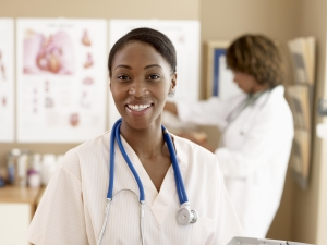 Female nurse standing with doctor, focus on nurse
