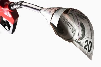 Close-up of gas pump sucking up money