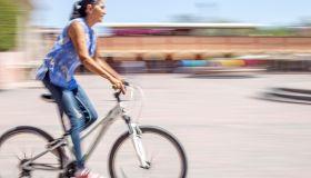 Latina woman, cycling