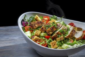 Healthy salad made with vegetables and chicken